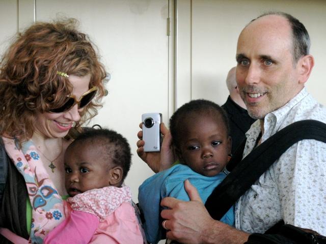 Elizabeth, husband and children arriving at New York's JFK International Airport
